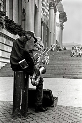 Picture of a jazz saxophone player near the steps to the Metropolitan Museum of Art in New York City.  Photo Credit: Joseph Constantino, all rights reserved.  Part of www.FreePhotoCourse.com's Contributor's Gallery, chosen to represent the best of the July 2011 submissions.