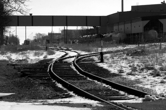FreePhotoCourse.com Contributor's Photo Gallery; Submit Your Photos like this one and we may post it for the world to see.  Windsor, Ontario train tracks behind Hiram Walker / Wisers whiskey distillery.  (c) 2011, all rights reserved.